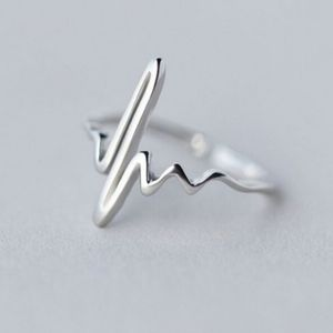 Silver adjustable heartbeat ring